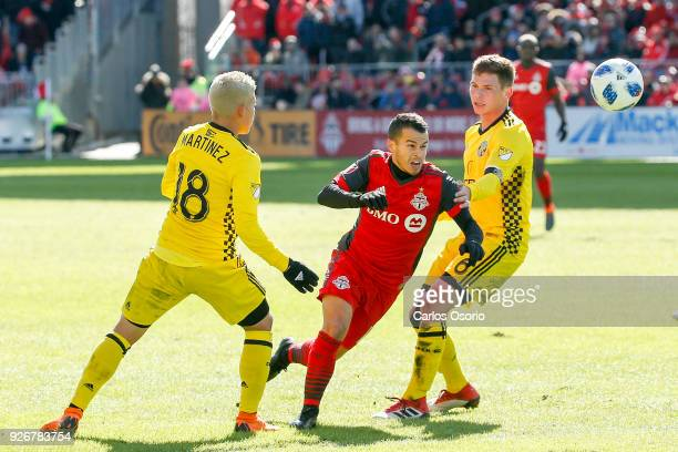 TORONTO ON MARCH 3 Sebastian Giovinco of TFC tries to squeeze past Cristian Martinez and Wil Trapp of Columbus during the 1st half of MLS action as...