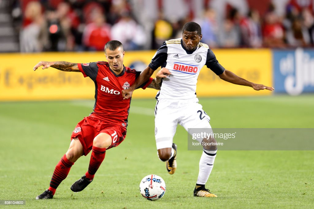Sebastian Giovinco (10) of Toronto FC battles for the ball against Ray Gaddis (28) of Philadelphia Union during the first half of the MLS Soccer regular season game between Toronto FC and Philadelphia Union on August 23, 2017, at BMO Field in Toronto, ON, Canada.