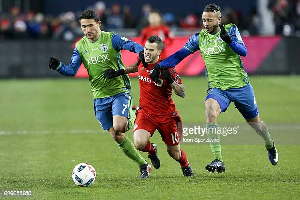 Sebastian Giovinco of Toronto FC battles for the ball against Cristian Roldan of Seattle Sounders during the MLS Cup Finals of the MLS Cup Final on...