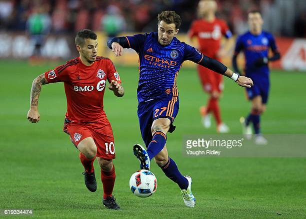 Sebastian Giovinco of Toronto FC battles for the ball with RJ Allen of New York City FC during the second half of an MLS Conference semifinal playoff...