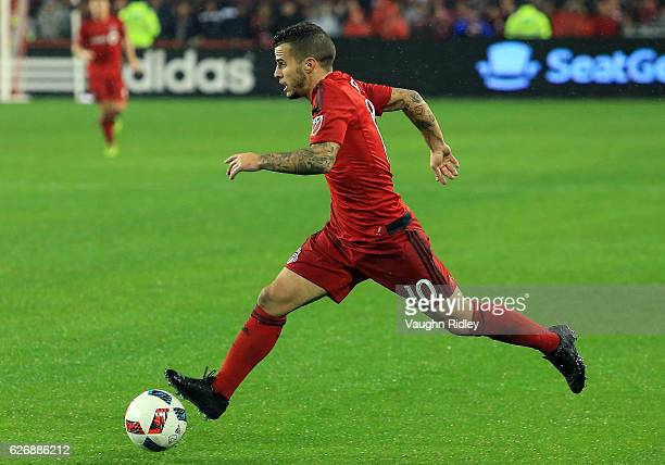 Sebastian Giovinco of Toronto FC dribbles the ball during the second half of the MLS Eastern Conference Final Leg 2 game against Montreal Impact at...