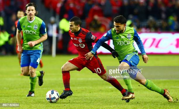 Sebastian Giovinco of Toronto FC fights for the ball with Cristian Roldan of the Seattle Sounders during the first half of the 2017 MLS Cup Final at...