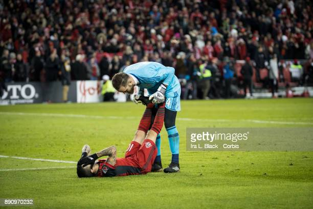 Sebastian Giovinco of Toronto FC gets a hand to stretch out his legs by Stefan Frei of Seattle Sounders during the 2017 Audi MLS Championship Cup...