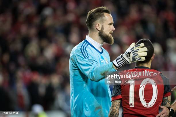 Sebastian Giovinco of Toronto FC gets a pat on his head from Stefan Frei of Seattle Sounders during the 2017 Audi MLS Championship Cup match between...