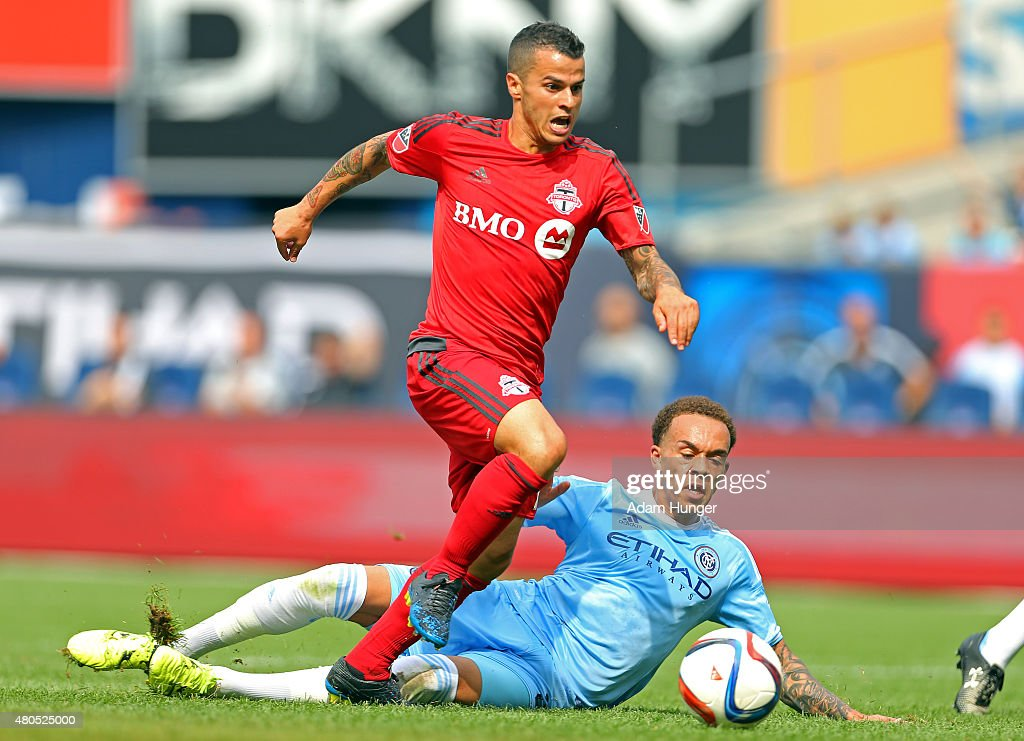 Sebastian Giovinco #10 of Toronto FC gets past New York City FC Shay Facey #24 during a soccer game at Yankee Stadium on July 12, 2015 in the Bronx borough of New York City.
