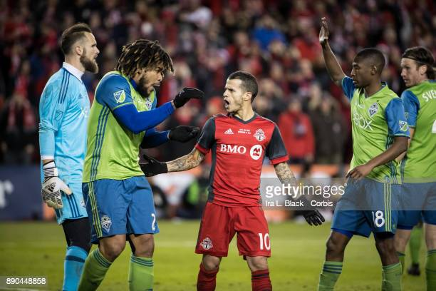 Sebastian Giovinco of Toronto FC has a few words with Roman Torres of Seattle Sounders during the 2017 Audi MLS Championship Cup match between...