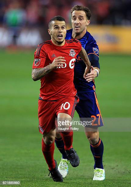 Sebastian Giovinco of Toronto FC is brought down by RJ Allen of New York City FC during the second half of an MLS Conference semifinal playoff game...