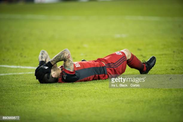 Sebastian Giovinco of Toronto FC is laid out on the field after a hit during the 2017 Audi MLS Championship Cup match between Toronto FC and Seattle...
