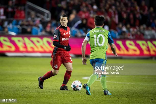 Sebastian Giovinco of Toronto FC looks for the open man against Nicolas Lodeiro of Seattle Sounders during the 2017 Audi MLS Championship Cup match...