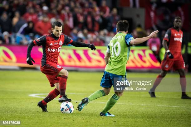 Sebastian Giovinco of Toronto FC tries to break away from Nicolas Lodeiro of Seattle Sounders during the 2017 Audi MLS Championship Cup match between...