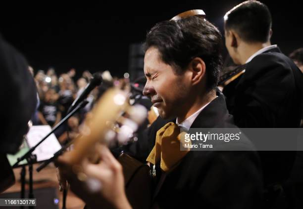 Sebastian Gonzalez becomes emotional while performing with his band Mariachi Puesta del Sol at the conclusion of an interfaith vigil for victims of a...