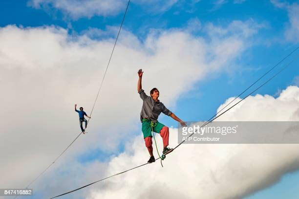 Sebastian Gum Chung Segraves and Daniel Laruelle of South Africa walk on lines during the Highline Extreme event in Moleson peak western Switzerland...