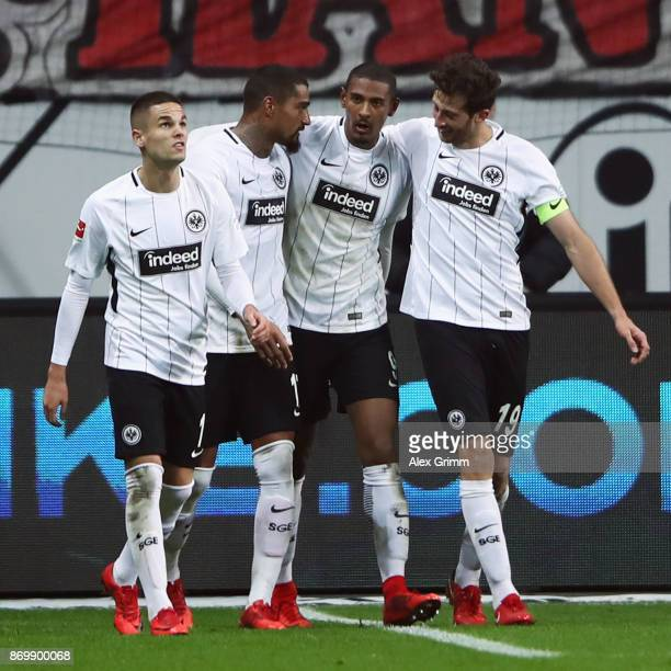 Sebastian Haller of Frankfurt celebrates his team's second goal with team mates Mijat Gacinovic KevinPrince Boateng and David Abraham during the...