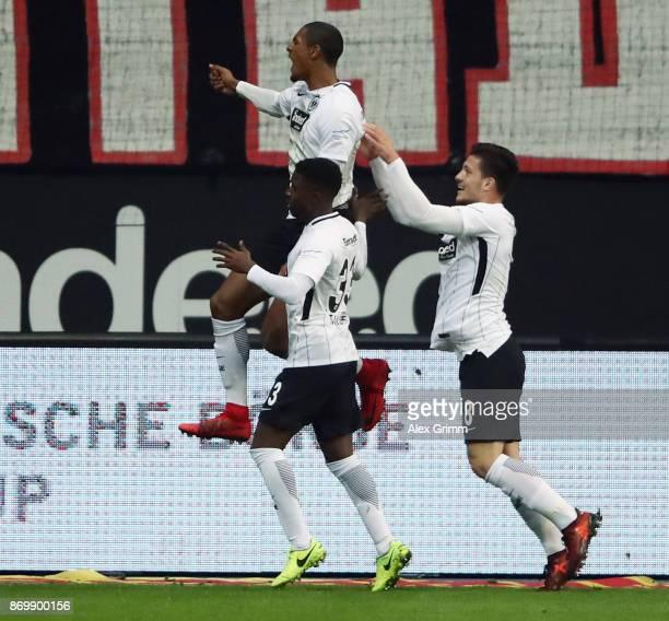 Sebastian Haller of Frankfurt celebrates his team's second goal with team mates Taleb Tawatha and Luka Jovic during the Bundesliga match between...