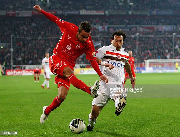 Sebastian Heidinger of Fortuna shoots as Fabio Morena of St. Pauli defends during the Second Bundesliga match between Fortuna Duesseldorf and FC St....