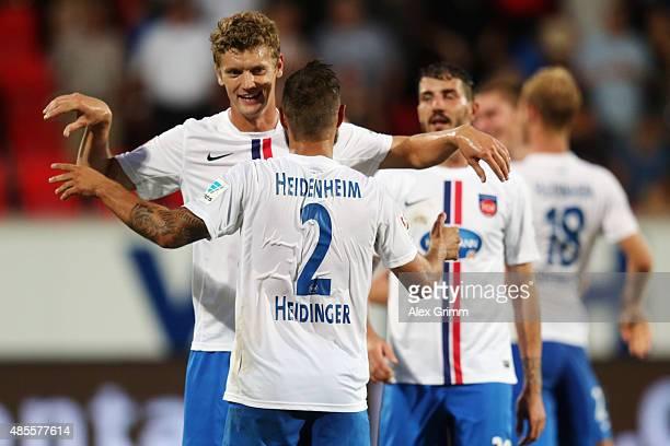 Sebastian Heidinger , Tim Goehlert and team mates of Heidenheim celebrate after the Second Bundesliga match between 1. FC Heidenheim and 1. FC...