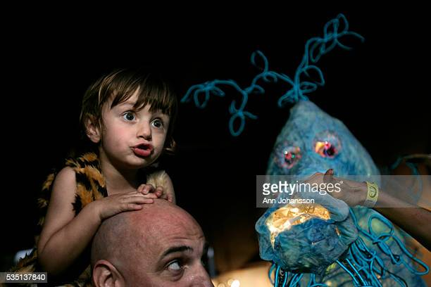 Sebastian Hennes sits on his father Chris' shoulders next to the Leafy Sea Dragon sculpture at the Los Angeles Burning Man in Los Angeles