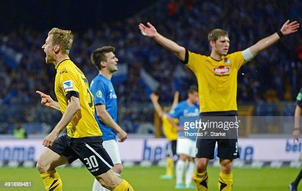 Sebastian Hille and Fabian Klos of Bielefeld celebrate their teams third goal during the Second Bundesliga Playoff First Leg match between Darmstadt...