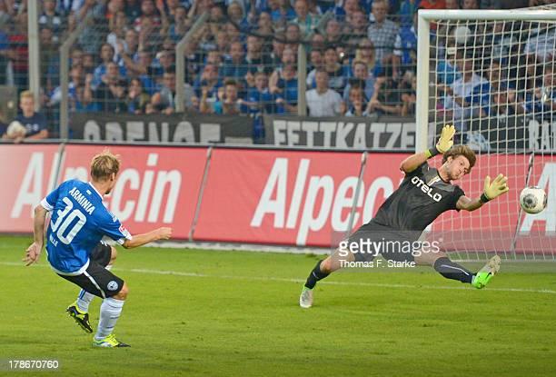 Sebastian Hille of Bielefeld scores the final goal against Fabian Giefer of Duesseldorf during the Second Bundesliga match between Arminia Bielefeld...