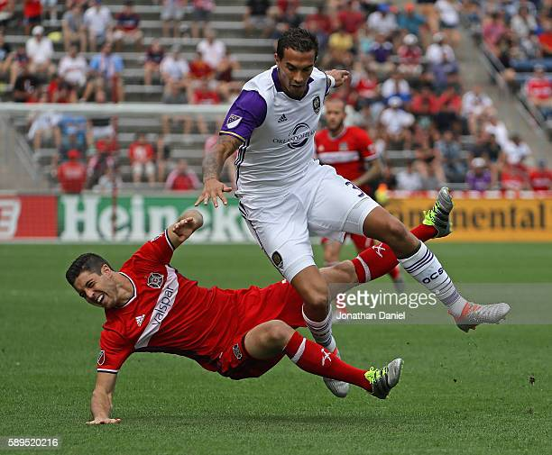 Sebastian Hines of Orlando City FC collides with Matt Polster of Chicago Fire during an MLS match at Toyota Park on August 14 2016 in Bridgeview...