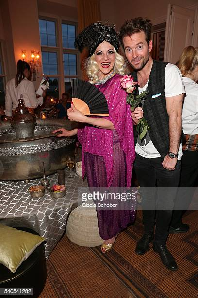 Sebastian Hoeffner and a Burlesque dancer during the 'Triumph Maison Party' at Palais Nr 6 Schloss Nymphenburg on June 15 2016 in Munich Germany