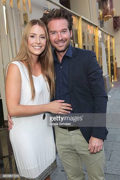 Sebastian Hoeffner and his girlfriend Patricia Hoepp attend the Eclat Dore summer party at Hotel Vier Jahreszeiten Kempinski on July 23 2014 in...
