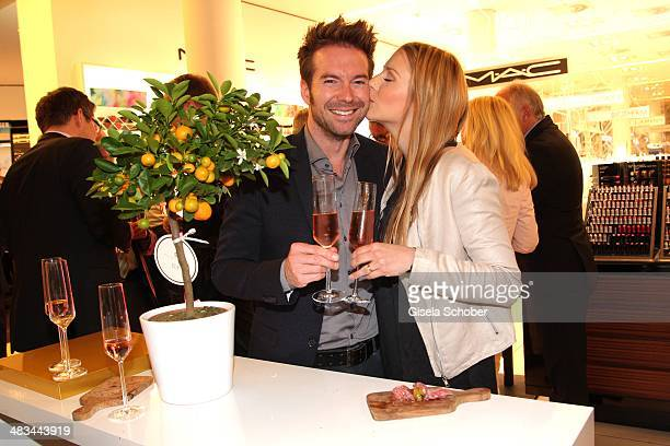 Sebastian Hoeffner and his girlfriend Patricia Hoepp attend the 'Studio Italia La Perfezione del Gusto' grand opening at Oberpollinger on April 8...