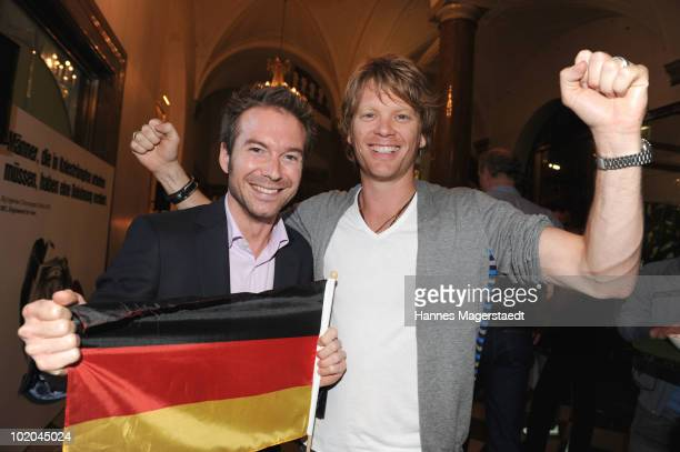 Sebastian Hoeffner and Mike Kraus attend the public viewing party for the first match of the German team during the world cup 2010 at the Lenbach on...