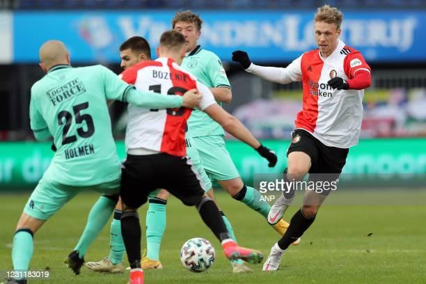 Sebastian Holmen or Willem II, Robert Bozenik of Feyenoord, Nicolai Jorgensen or Feyenoord during the Dutch Eredivisie match between Feyenoord...