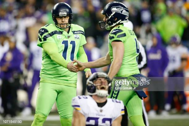 Sebastian Janikowski and Michael Dickson of the Seattle Seahawks celebrate a field goal in the third quarter as Harrison Smith of the Minnesota...