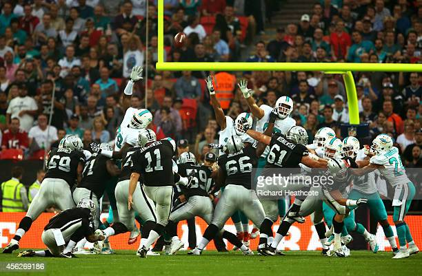 Sebastian Janikowski of the Oakland Raiders adds the extra point to the touchdown scored by teammate Brian Leonhardt of the Oakland Raiders during...
