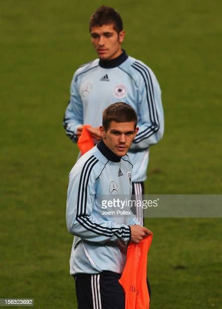 Sebastian Jung and Roman Neustaedter of Germany are seen during a training session on the eve of their friendly international match against the...