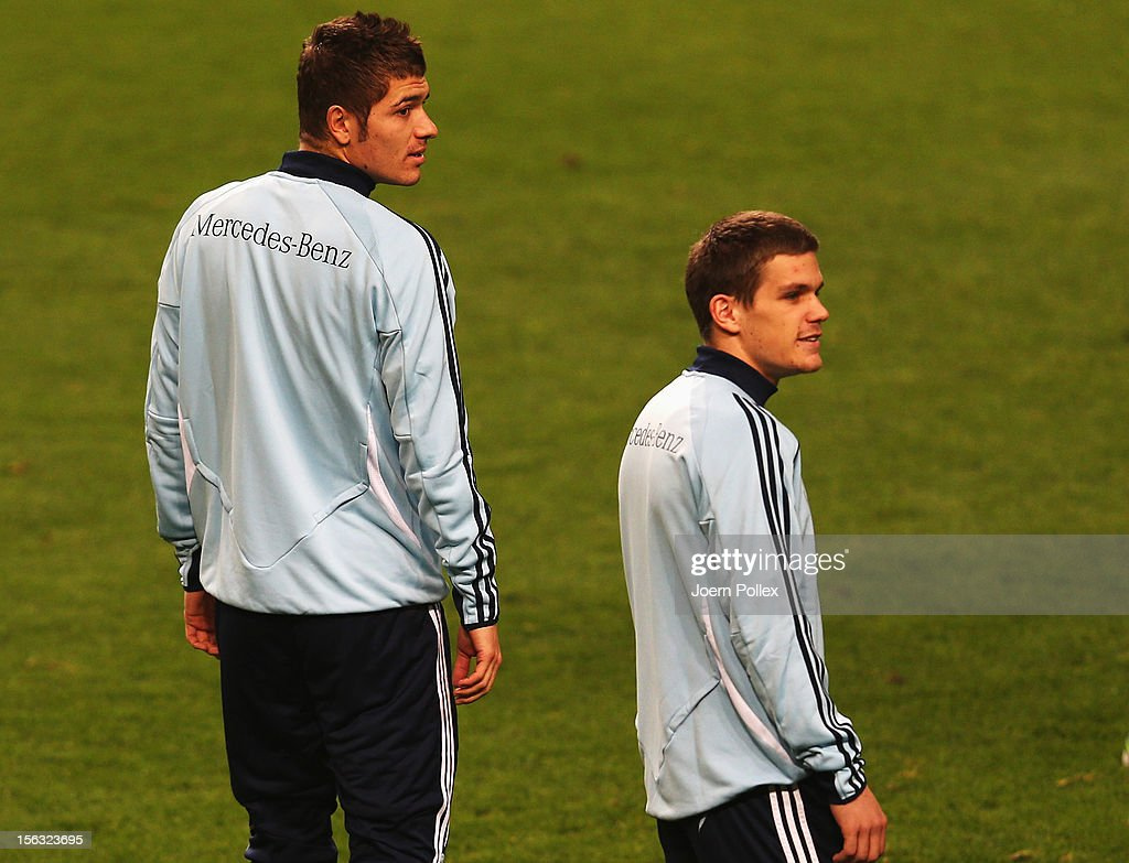 Sebastian Jung (R) and Roman Neustaedter of Germany are seen during a training session, on the eve of their friendly international match against the Netherlands, at Amsterdam Arena on November 13, 2012 in Amsterdam, Netherlands.