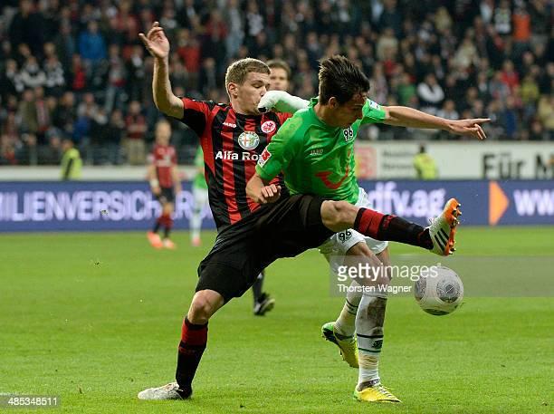 Sebastian Jung of Frankfurt battles for the ball with Edgar Prib of Hannover during the Bundesliga match between Eintracht Frankfurt and Hannover 96...