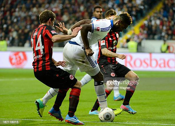 Sebastian Jung of Frankfurt battles for the ball with Jonathan Tah of Hamburg during the Bundesliga match between Eintracht Frankfurt and Hamburger...