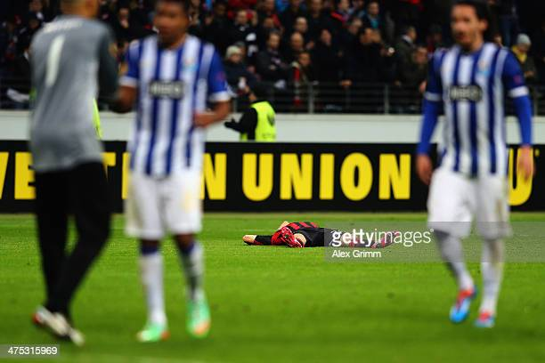 Sebastian Jung of Frankfurt reacts as players of Porto celebrate after the UEFA Europa League Round of 32 second leg match between Eintracht...