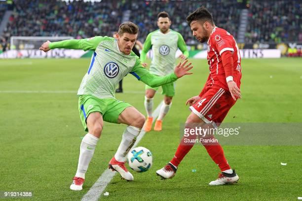 Sebastian Jung of Wolfsburg fights for the ball with Juan Bernat of Bayern Muenchen during the Bundesliga match between VfL Wolfsburg and FC Bayern...