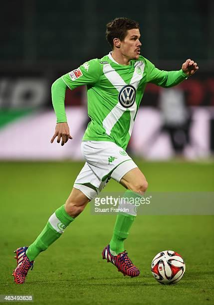 Sebastian Jung of Wolfsburg in action during the Bundesliga match between VfL Wolfsburg and 1899 Hoffenheim at Volkswagen Arena on February 7 2015 in...