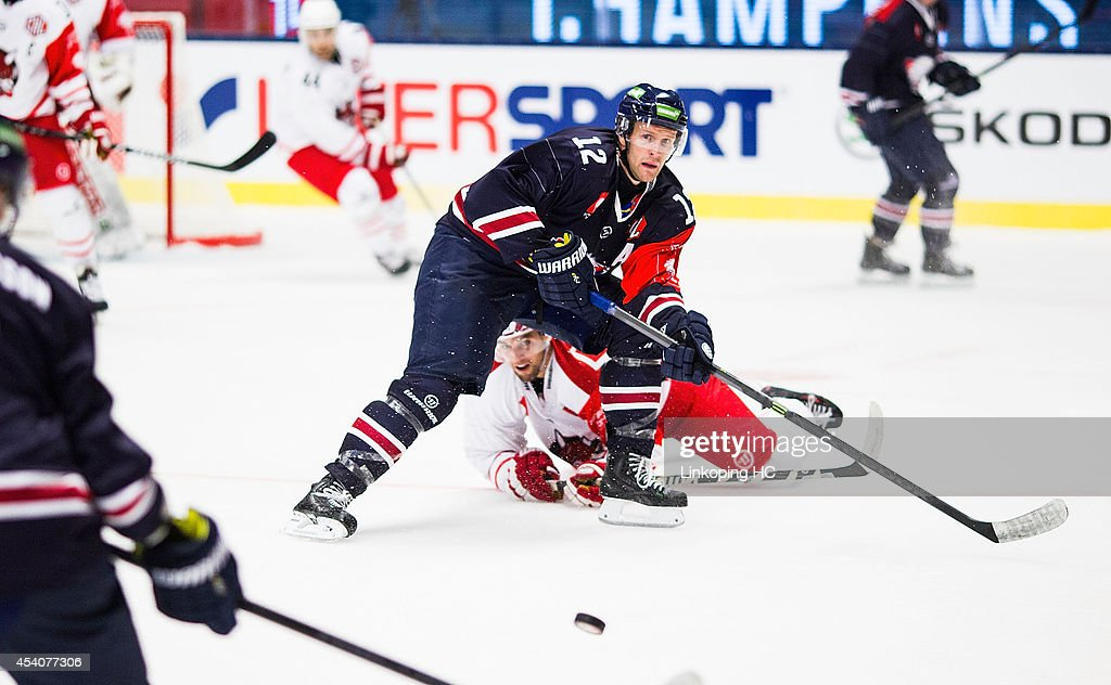 Sebastian Karlsson #12 of Linkoping HC makes a pass during the Champions Hockey League group stage game between Linkoping HC and HC Bolzano on August 24, 2014 in Linkoping, Sweden.