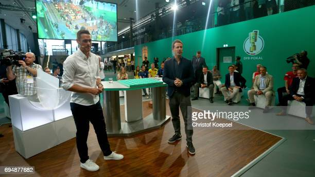 Sebastian Kehl and Alexander Bommes ARD moderator attend the DFB Cup Draw at Deutsches Fussballmuseum on June 11 2017 in Dortmund Germany