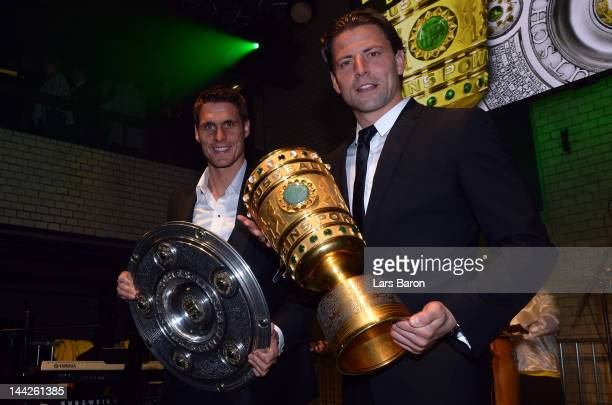 Sebastian Kehl and goalkeeper Roman Weidenfeller are seen during the Borussia Dortmund party at the Ewerk on May 13 2012 in Berlin Germany