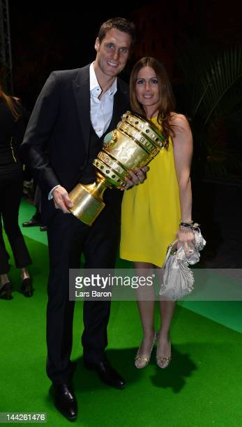 Sebastian Kehl and his girlfriend Tina pose with the cup during the Borussia Dortmund party at the Ewerk on May 13 2012 in Berlin Germany