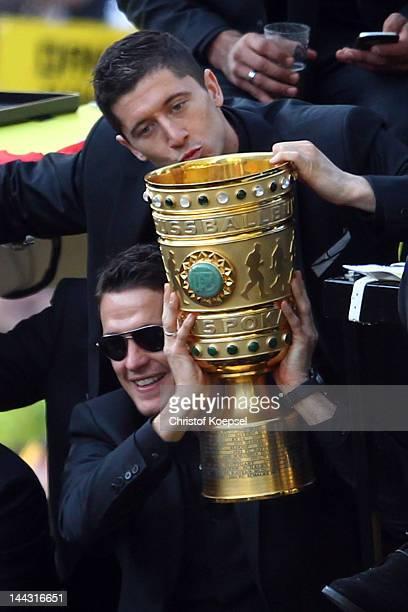 Sebastian Kehl and Robert Lewandowski of Dortmund celebrate with the trophy during a parade at Borsigplatz celebrating Borussia Dortmund's Bundesliga...