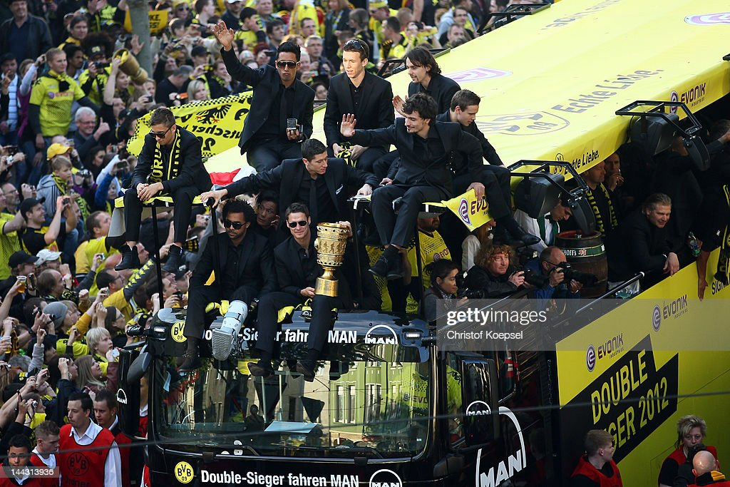 Sebastian Kehl holds the DFB tropy and celebrates with his team during a parade at Borsigplatz celebrating Borussia Dortmund's Bundesliga and DFB Cup win on May 13, 2012 in Dortmund, Germany.