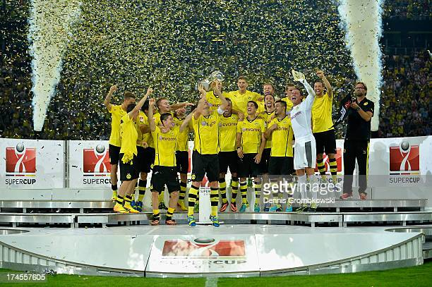 Sebastian Kehl of Borussia Dortmund lifts the trophy after the DFL Supercup match between Borussia Dortmund and FC Bayern Muenchen at Signal Iduna...