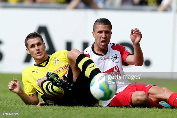 Sebastian Kehl of Dortmund and David Jahdadic Wilhelmshaven compete for the ball during the first round of DFB Cup match between SV Wilhelmshaven and...