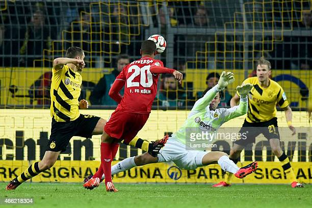Sebastian Kehl of Dortmund and his team mate keeper Roman Weidenfeller battle for the ball with Deyverson Brum Silva Acosta of Koeln during the...