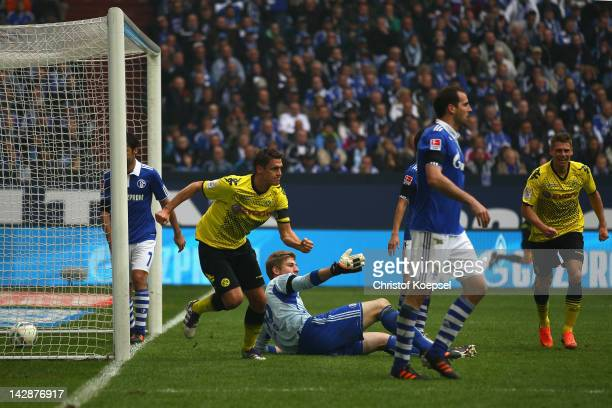 Sebastian Kehl of Dortmund celebrates the second goal against Schalke during the Bundesliga match between FC Schalke 04 and Borussia Dortmund at...