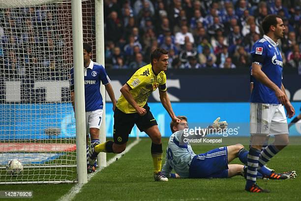 Sebastian Kehl of Dortmund celebrates the second goal against Schalke during the Bundesliga match between FC Schalke 04 and Borussia Dortmund at...