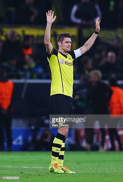 Sebastian Kehl of Dortmund celebrates victory after during the UEFA Champions League round of 16 second leg match between Borussia Dortmund and FC...